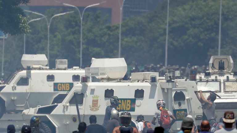 "Opposition demonstrators face military vehicles near the Generalisimo Francisco de Miranda Airbase ""La Carlota"" in Caracas, Venezuela April 30, 2019"