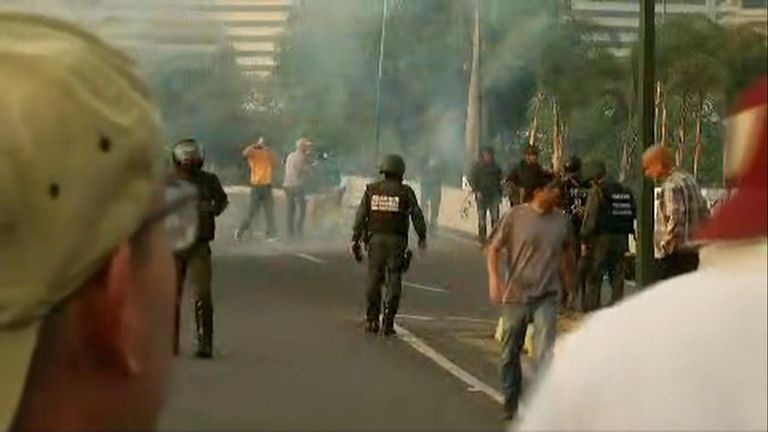Tear gas has been fired on the road near the Caracas air base where Mr Guaido had been.