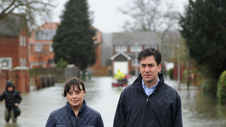 Labour leader Ed Miliband (right) and Victoria Groulef (left), Labour's Parliamentary Candidate for Reading West, during a visit to the recent flooding in Purley on Thames in Berkshire PRESS ASSOCIATION Photo. Picture date: Tuesday February 11, 2014. See PA story POLITICS . Photo credit should read: Andrew Matthews/PA Wire