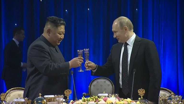 Vladimir Putin and Kim Jong Un attend an official reception following their talks in Vladivostok, Russia