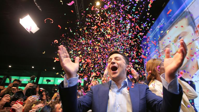 Ukrainian presidential candidate Volodymyr Zelenskiy reacts following the announcement of the first exit poll in a presidential election at his campaign headquarters in Kiev, Ukraine April 21, 2019