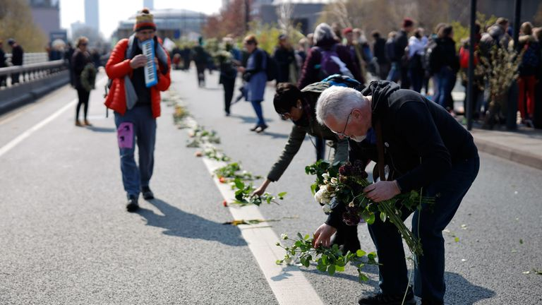 Extinction Rebellion activists lay flowers on Waterloo Bridge