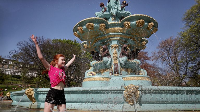 Zoe Beatson, 11, cools off in the Ross Fountain in Edinburgh's Princes Street Gardens