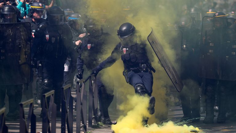 Protesters threw flares in response to tear gas in Paris