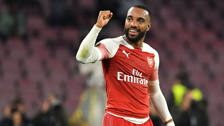 Arsenal's French striker Alexandre Lacazette celebrates after opening the scoring during the UEFA Europa League quarter-final second leg football match Napoli vs Arsenal on April 18, 2019 at the San Paolo stadium in Naples. (Photo by Andreas SOLARO / AFP) (Photo credit should read ANDREAS SOLARO/AFP/Getty Images)