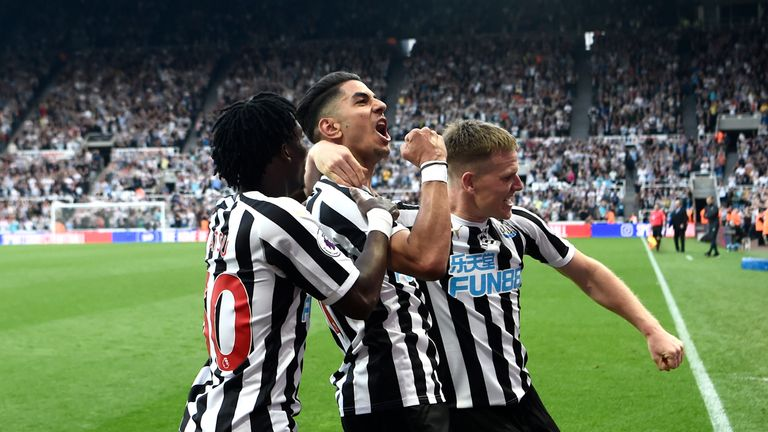 Ayoze Perez celebrates with team-mates after completing his hat-trick