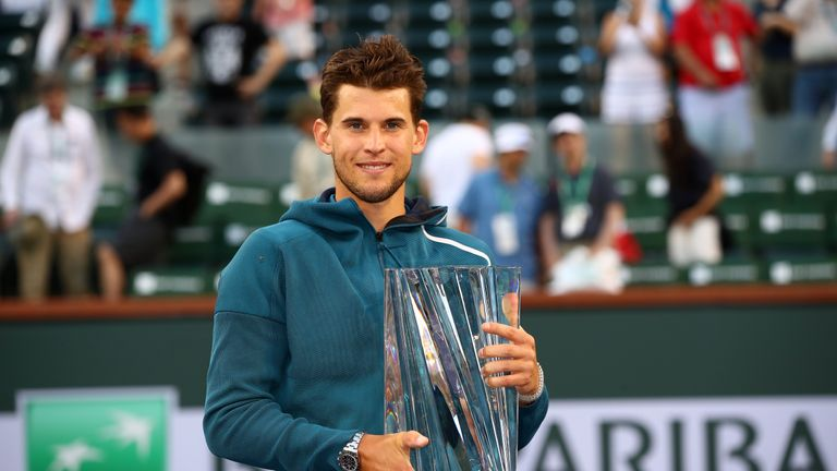 Dominic Thiem of Austria holds the championship trophy after his men's singles final victory against Roger Federer of Switzerland on day fourteen of the BNP Paribas Open at the Indian Wells Tennis Garden on March 17, 2019 in Indian Wells, California