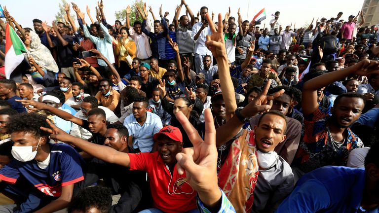 Cheers amid reports Sudan's president has stood down