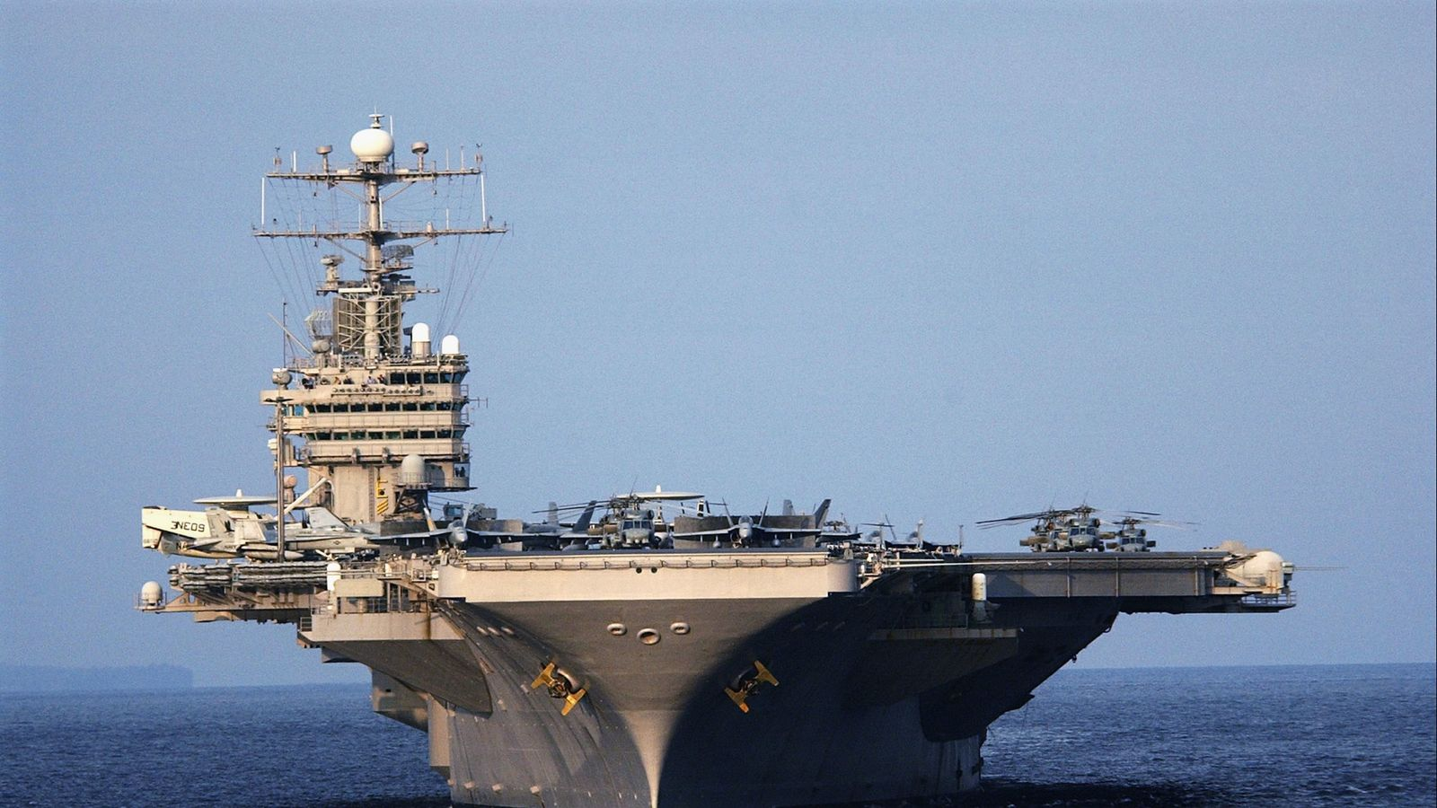 US warns Iran of 'unrelenting force' as it deploys carrier