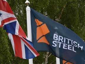 The British Steel flag flies at the entrance to the steelworks in Scunthorpe