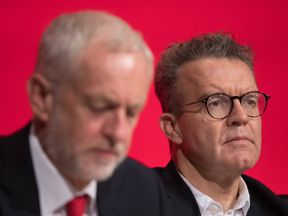 Labour leader Jeremy Corbyn (left) and deputy leader Tom Watson attend the start of their party's annual conference at the Arena and Convention Centre (ACC), in Liverpool.