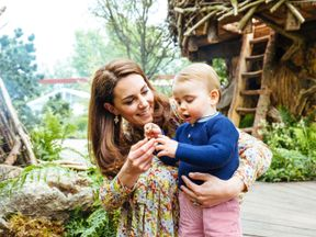 Duchess of Cambridge with Prince Louis in the 'Back to Nature' garden