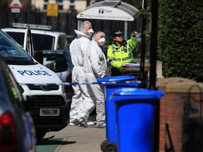 Forensics officers at the scene in Sheffield