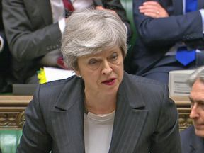 Theresa May answering questions in the House of Commons.