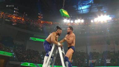 Andrade powerbombs Balor onto a ladder!