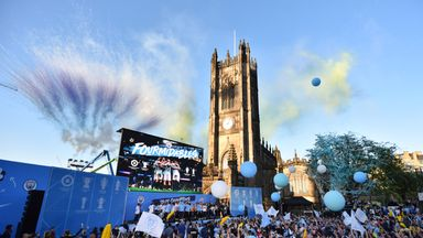 City sides on open-top bus parade