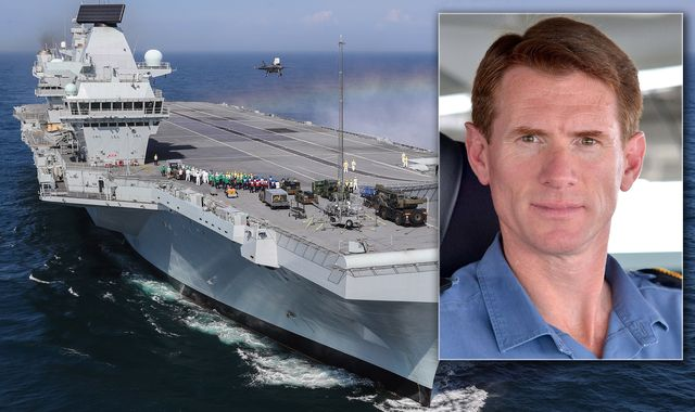 Sacked captain still in command despite being flown off aircraft carrier