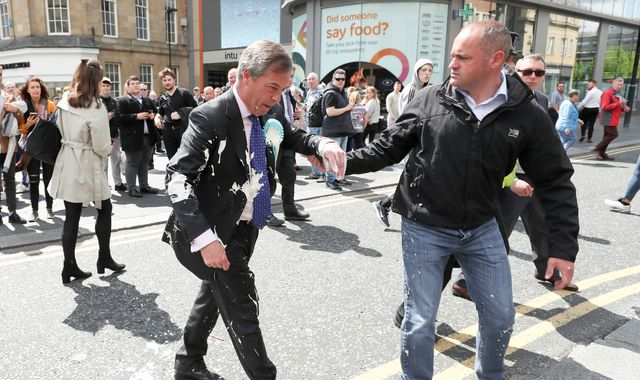 Man who threw milkshake at Nigel Farage pleads guilty to assault and criminal damage