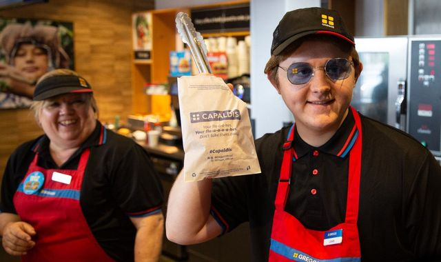 Lewis Capaldi takes a break from festival to serve up sausage rolls in Greggs