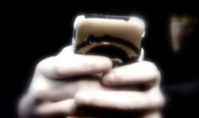 'Corrosive' mobile phones should be totally banned in schools