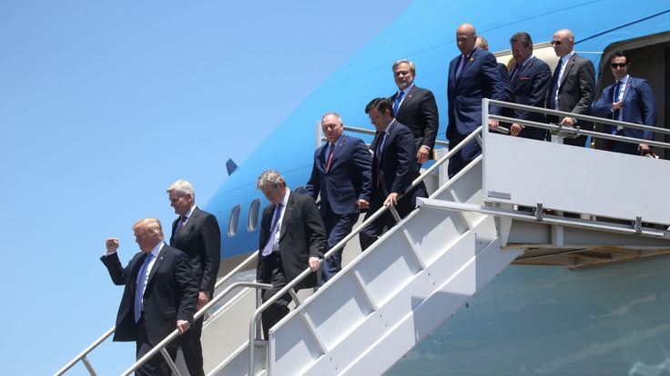 Donald Trump leaving Air Force One with a large delegation
