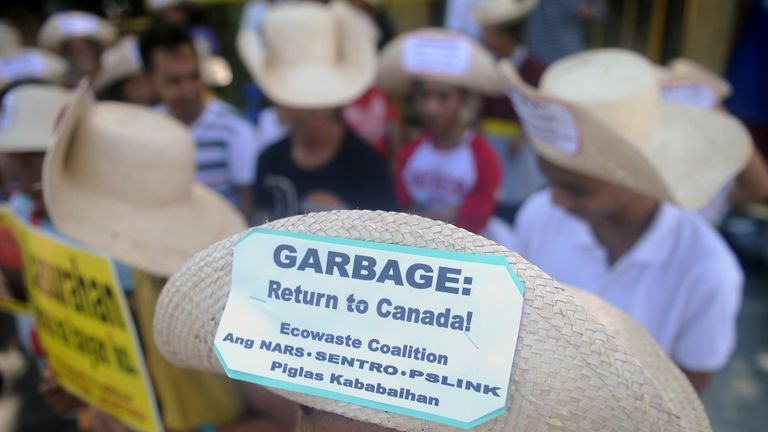 Environmental activists rally outside the Philippine Senate in Manila on September 9, 2015 to demand that scores of containers filled with household rubbish be shipped back to Canada and to push for the ratification of the Basel Ban Amendment which prohibits the export of hazardous waste from developed to developing countries. Philippine officials said in July, 2015 that tonnes of imported Canadian rubbish had been sent to a northern Philippines landfill, ending a two-year standoff with activists who called for the waste to be returned to Canada.      AFP PHOTO / Jay DIRECTO        (Photo credit should read JAY DIRECTO/AFP/Getty Images)