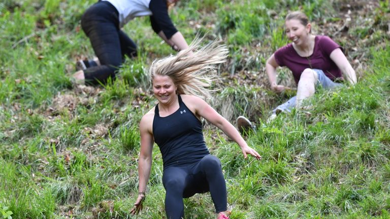 Participants take part in the women's race during the annual cheese rolling competition at Cooper's Hill in Brockworth, Gloucestershire.
