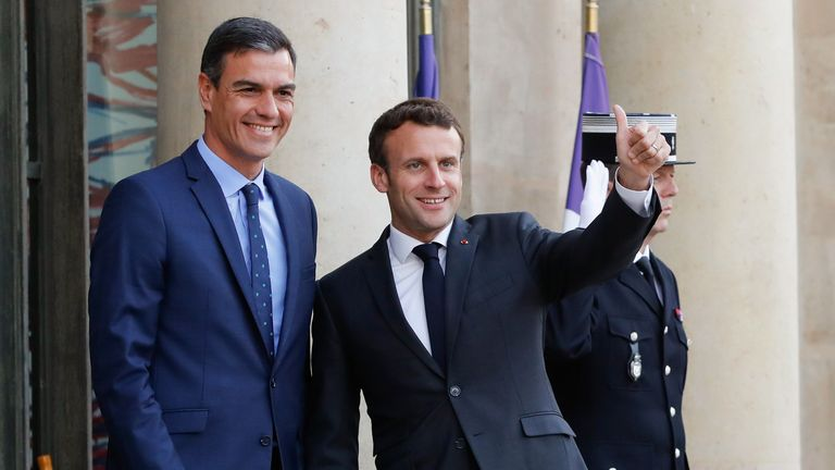 French President Emmanuel Macron (L) gestures and welcomes Spanish Prime Minister Pedro Sanchez upon his arrival prior to a state dinner at the Elysee Palace, in Paris on May 27, 2019. (Photo by FRANCOIS GUILLOT / AFP)        (Photo credit should read FRANCOIS GUILLOT/AFP/Getty Images)