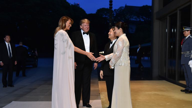 US President Donald Trump (2nd L) and First Lady Melania Trump (L) are greeted by Japan's Emperor Naruhito (C) and Empress Masako (R) upon their arrival at the Imperial Palace for a state banquet in Tokyo on May 27, 2019. (Photo by Kazuhiro NOGI / POOL / AFP)        (Photo credit should read KAZUHIRO NOGI/AFP/Getty Images)