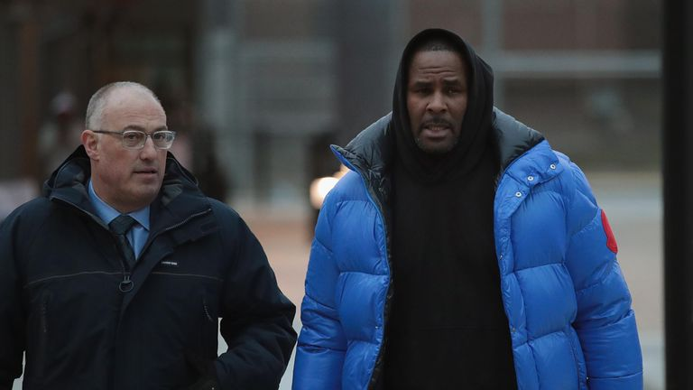 CHICAGO, ILLINOIS - FEBRUARY 25: R&B singer R. Kelly (R) and his attorney Steve Greenberg leave Cook County jail after Kelly posted $100 thousand bond on February 25, 2019 in Chicago, Illinois.  Kelly was being held after turning himself in to face ten counts of aggravated sexual abuse.  (Photo by Scott Olson/Getty Images)