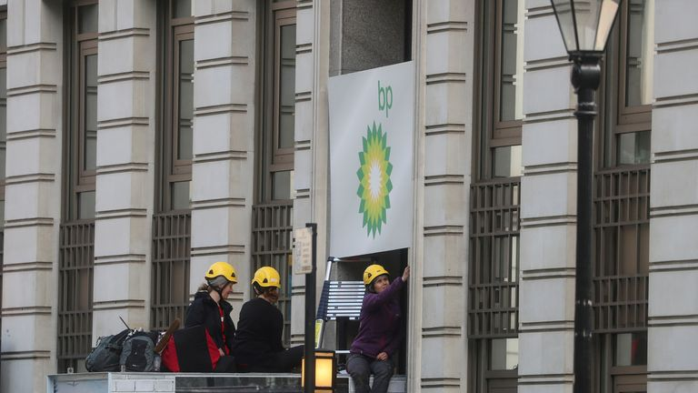 Greenpeace activists block an entrance to the BP headquarters in London