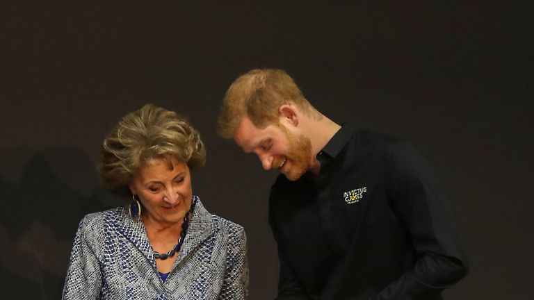 Prince Harry was presented with the babygro by Princess Margriet of the Netherlands