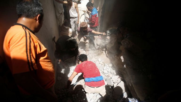 People search for survivors under the rubble at the site of an air strike launched by the Saudi-led coalition in Sanaa, Yemen on Thursday