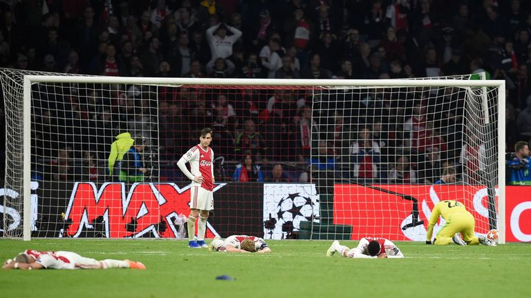 Ajax players react after losing their UEFA Champions League semi-final second leg football match against Tottenham at the Johan Cruyff Arena, in Amsterdam, on May 8, 2019