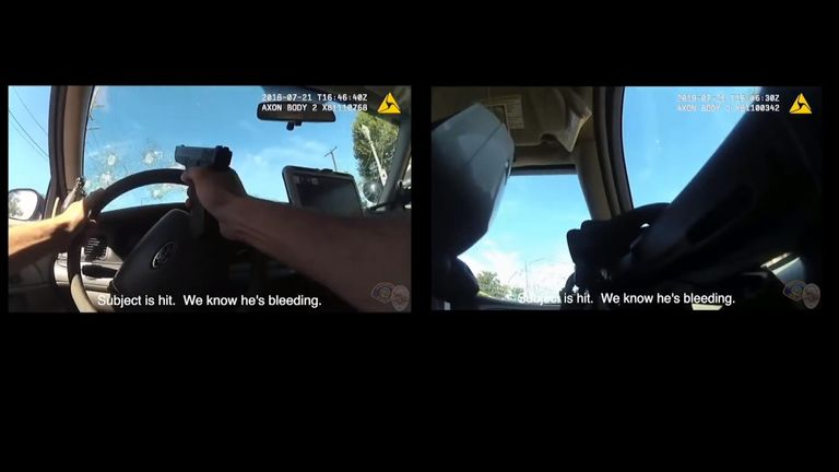 The officer driving the patrol car fired shots through his own windscreen
