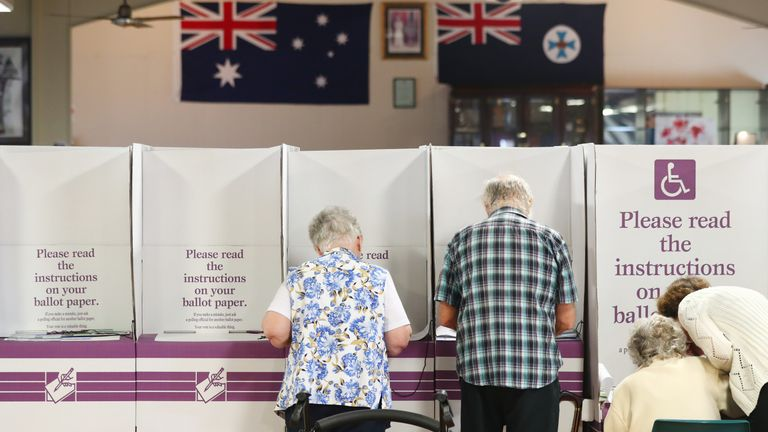People vote at Burleigh Heads R.S.L Hall on May 18, 2019 in Gold Coast, Australia. Australians head to the polls today to elect the 46th Parliament of Australia, with a tight battle between incumbent Prime Minister Scott Morrison of the Coalition party and Labor Leader, Bill Shorten