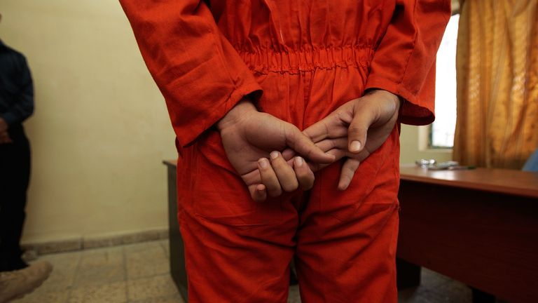 An arrested Iraqi man stands before Iraqi judges in a makeshift courtroom November 6, 2007 in Baghdad, Iraq