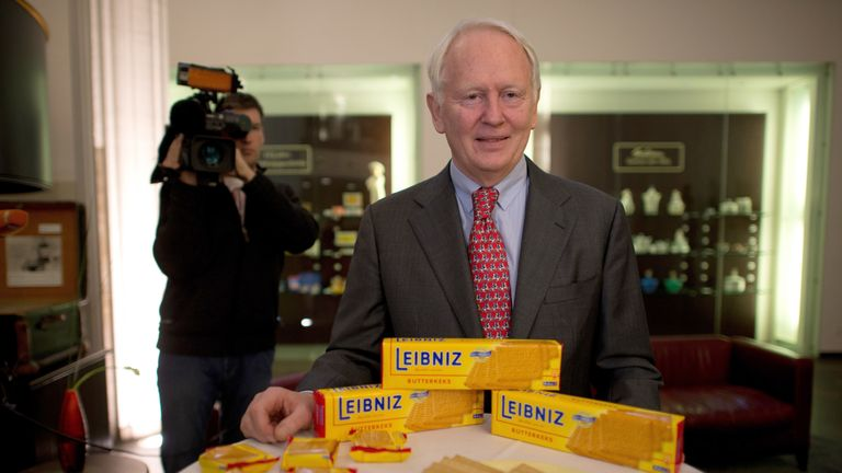 Bahlsen CEO Werner Michael Bahlsen stands on a table displaying Leibniz cookies at the company's headquarters in Hanover, northern Germany, on January 30, 2013.