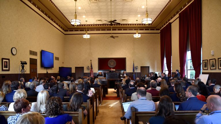 Judge Thad Balkman welcomes a full court on the first day of a trial of Johnson & Johnson and Teva Pharmaceutical Industries over claims they engaged in deceptive marketing that contributed to the national opioid epidemic in Norman, Oklahoma, U.S. May 28, 2019