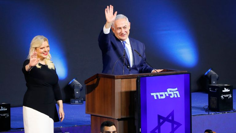 Israeli Prime Minister Benjamin Netanyahu, accompanied by his wife Sara, greets supporters at his Likud Party headquarters in the Israeli coastal city of Tel Aviv on election night early on April 10, 2019