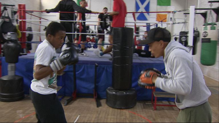 Dante Smith (left) and his coach Giz Chu during boxing training