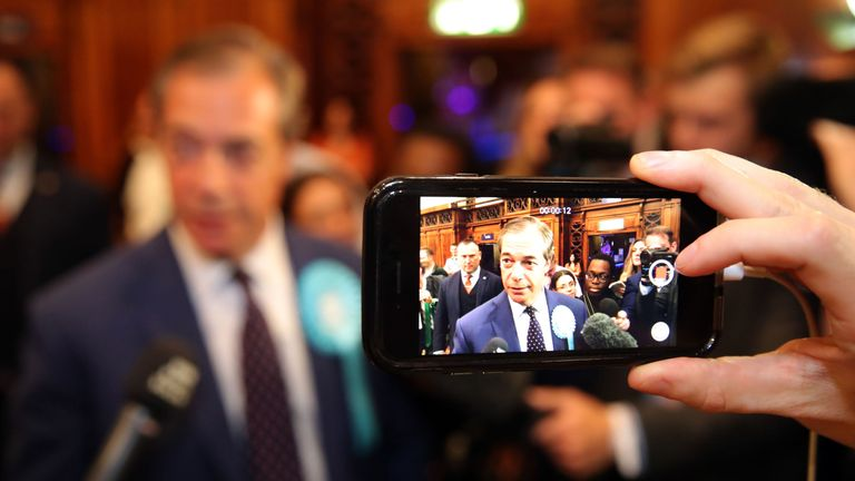 Brexit Party leader Nigel Farage is filmed on a phone by a member of the media after the European Parliamentary elections count at the Guildhall in Southampton