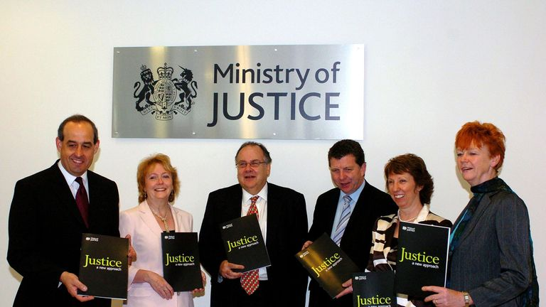 From left, David Hanson, Bridget Prentice , Lord Falconer, Gerry Sutcliffe, Baroness Ashton and Vera Baird line up in front of a new Ministry of Justice sign in the lobby of Selbourne House, Victoria, central London.