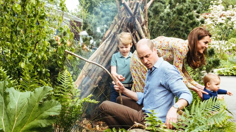 Duke and Duchess of Cambridge with Prince George and Prince Louis in the garden