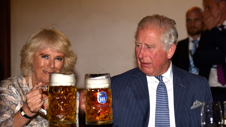 Camilla and Charles cheers their beers before trying them