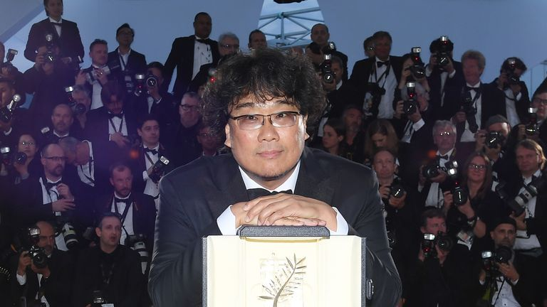 "CANNES, FRANCE - MAY 25: Director Bong Joon-Ho, winner of the Palme d'Or award for his film ""Parasite"" poses at the winner photocall during the 72nd annual Cannes Film Festival on May 25, 2019 in Cannes, France. (Photo by Pascal Le Segretain/Getty Images)"