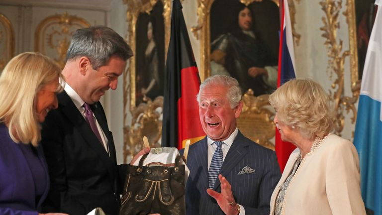 Charles looked delighted with the lederhosen