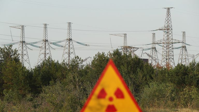 A radiation sign near electricity pylons inside the exclusion zone
