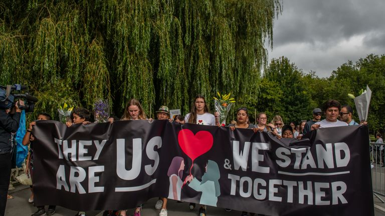 People march to remember the victims of the Christchurch mosque shootings