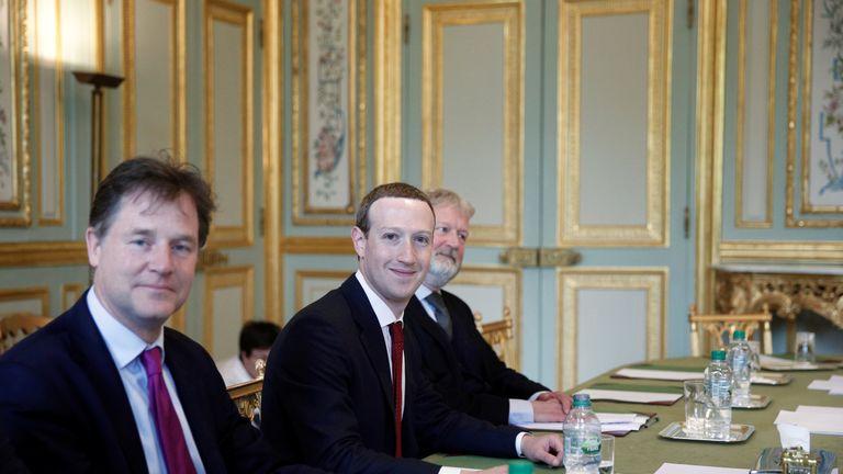 Macron greets Zuckerberg with threat to regulate Facebook